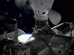 The Dragon cargo capsule docks at the International Space Station (Nasa/AP)