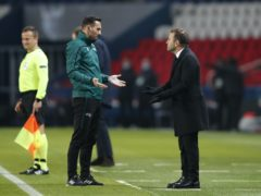Istanbul Basaksehir manager Okan Buruk, right, argues with an official during the match with Paris St Germain (Francois Mori/AP).