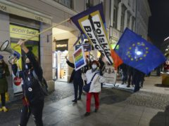 Protesters carry an EU flag at an anti-government protest in Warsaw (AP/Czarek Sokolowski, File)