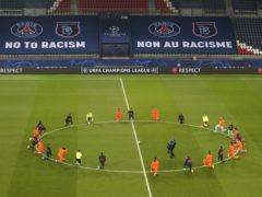 Paris St Germain and Istanbul Basaksehir kneel to show support for the fight against racism (Xavier Laine/AP)