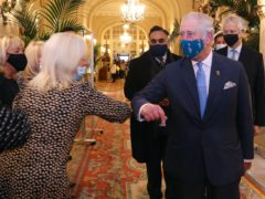The Prince of Wales wears a face mask as he elbow bumps staff during a visit to The Ritz in London, in support of the hospitality sector (Chris Jackson/PA)