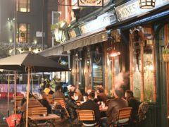 People sat outside a pub in the West End of London after the announcement that the capital and parts of Essex and Hertfordshire will face Tier 3 restrictions from Wednesday (PA)