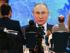Russian President Vladimir Putin speaks via video call during a news conference in Moscow (Alexander Zemlianichenko/AP)