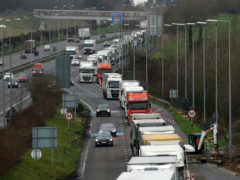 Lorries queue to enter the Eurotunnel site in Folkestone, Kent, due to heavy freight traffic (Gareth Fuller/PA)