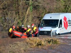 Emergency services rescue a DPD delivery van driver stranded in flood water in Newbridge on Usk, in Wales (Ben Birchall/PA)
