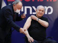 Israeli prime minister Minister Benjamin Netanyahu receives a coronavirus vaccine (Amir Cohen/AP)