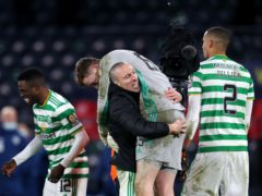 Conor Hazard (being lifted) was Celtic's hero (Andrew Milligan/PA)