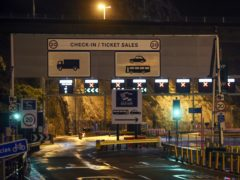 Police and port staff turn away vehicles from the Port of Dover in Kent which has been closed after the French government's announcement it will not accept any passengers arriving from the UK for the next 48 hours amid fears over the new mutant coronavirus strain.