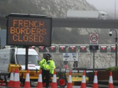 Police and port staff at the Port of Dover in Kent which has been closed after the French government's announcement it will not accept any passengers arriving from the UK for the next 48 hours amid fears over the new mutant coronavirus strain (Steve Parsons/PA)