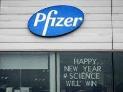 A sign in the window of an office at Pfizer Manufacturing in Puurs, Belgium (Valentin Bianchi/AP)