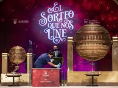 A worker disinfects an area at Madrid's Teatro Real opera house during Spain's bumper Christmas lottery draw known as El Gordo, or The Fat One, in Madrid, Spain (Bernat Armangue/AP)