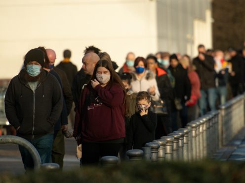 Shoppers queue at a Costco wholesalers in Birmingham ahead of Christmas (Jacob King/PA)