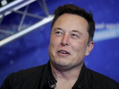 Elon Musk said he once considered selling the electric car maker to Apple (Hannibal Hanschke/Pool Photo via AP)