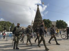 A Palestinian National security unit is deployed at Manger Square, adjacent to the Church of the Nativity, traditionally believed by Christians to be the birthplace of Jesus Christ, ahead of Christmas, in the West Bank city of Bethlehem (Nasser Nasser/AP)