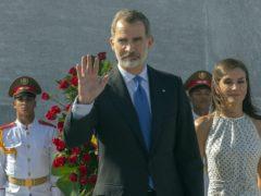 Spain's King Felipe VI waves as Queen Letizia walks with him on a visit to Cuba (Ramon Espinosa/AP)