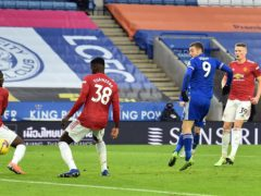 Jamie Vardy's shot goes in off Axel Tuanzebe to earn Leicester a draw. (Glyn Kirk/PA)