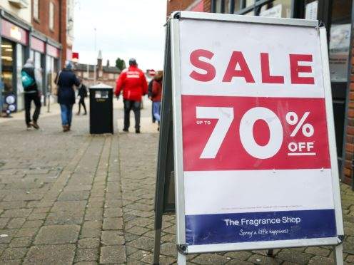 Shoppers in Newcastle-under-Lyme, Staffordshire, during the Boxing Day sales. Boxing Day spending is expected to fall by more than a quarter compared with a year ago, after extensive new Covid-19 restrictions forced non-essential retailers to close (Barrington Coombs/PA)