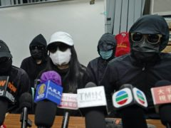 Relatives of a group of Hong Kong activists detained at sea by Chinese authorities attend a press conference on Monday. A Chinese court has sentenced 10 of the activists to prison sentences of up to three years on Wednesday (Kin Cheung/AP)