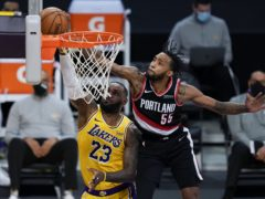 Portland Trail Blazers forward Derrick Jones Jr blocks a shot by Los Angeles Lakers forward LeBron James (Ashley Landis/AP)