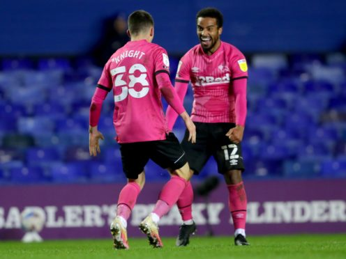 Derby's Jason Knight, left, celebrates scoring his side's fourth goal at St Andrew's (David Davies/PA)