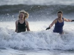 Swimmers in the freezing North Sea at King Edward's Bay near Tynemouth on New Year's Eve (Owen Humphreys/PA)