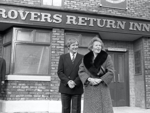 Margaret Thatcher outside the Rovers Return with William Roache, who plays Ken Barlow (PA)