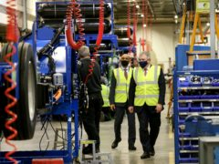 Brandon Lewis visited Ballymena-based Wrightbus as the funding was announced (NIO/PA)