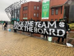Protest banner outside Celtic Park (Ronnie Esplin/PA)