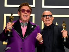 Sir Elton John and Bernie Taupin with their best original song Oscar at the 92nd Academy Awards (Jennifer Graylock/PA)