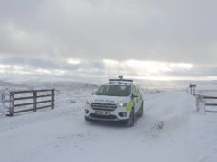 Durham Police were called out to the snowy moors and found a group of 13 people having a barbecue (Durham Police/PA)