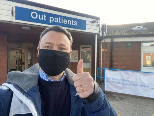 Brendan Clarke-Smith outside Retford Hospital, where he had a Covid-19 jab which was 'left over' from the day's vaccinations (Brendan Clarke-Smith/PA)