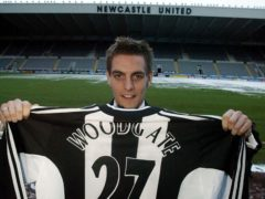 Jonathan Woodgate displays his new shirt after signing for Newcastle (Owen Humphreys/PA)