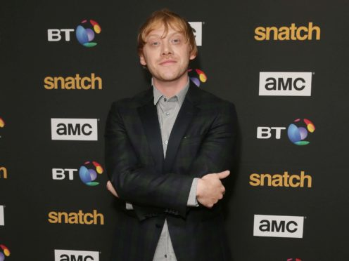 Harry Potter star Rupert Grint described smashing Sir David Attenborough's Instagram record as 'very surreal' (Tim Ireland/PA)