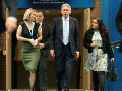 Ex-chancellor Philip Hammond walks with his then aides Poppy Trowbridge (left) and Sonia Khan (right) (Aaron Chown/PA)