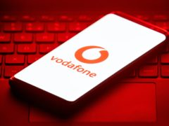 The logo of mobile phone network Vodafone is displayed on the screen of a smartphone.