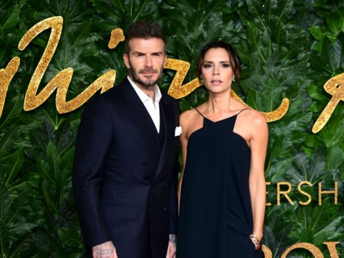 David and Victoria Beckham have paid themselves big dividends. (Ian West/PA)