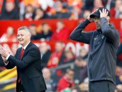 Ole Gunnar Solskjaer, left, is looking to get the best of Jurgen Klopp on Sunday (Martin Rickett/PA)