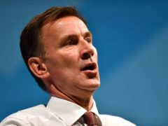 Jeremy Hunt thinks current rules on face coverings are not enough to deal with new Covid-19 variants (Jacob King/PA)
