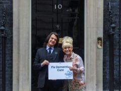 Dame Barbara Windsor and her husband Scott Mitchell (Simon Dawson/PA)