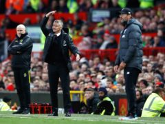 Manchester United manager Ole Gunnar Solskjaer (centre) gestures on the touchline as assistant Mike Phelan (left) and Liverpool manager Jurgen Klopp look on during the Premier League match at Old Trafford, Manchester.