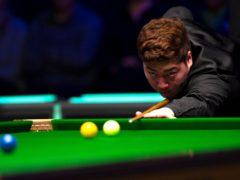Yan Bingtao beat John Higgins to claim his first Masters title (Zac Goodwin/PA)