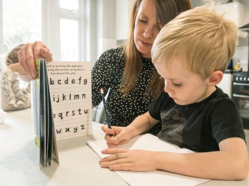 Jack, five, from Essex, does his home schoolwork (Ian West/PA)