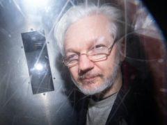 Assange is in high security Belmarsh prison (Dominic Lipinski/PA)
