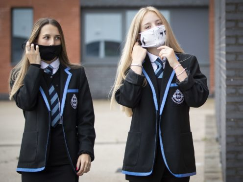 School pupils put on their protective face masks (PA)