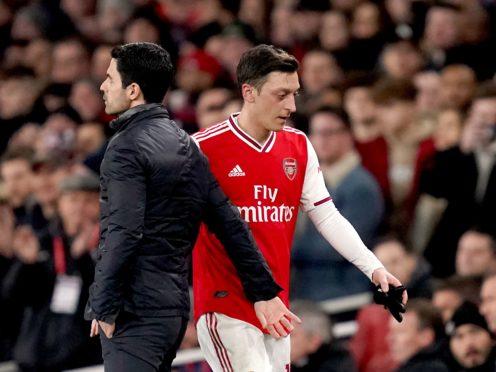 Mesut Ozil and manager Mikel Arteta look set to part ways (John Walton/PA)