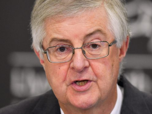 """First Minister Mark Drakeford speaking at a press conference in Cardiff ahead of Wales entering a two-week """"firebreak"""" lockdown at 6pm on Friday in an attempt to protect the country's NHS from being overwhelmed by the resurgence of coronavirus."""