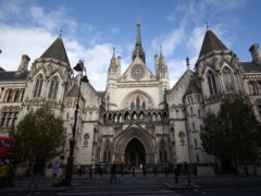 A judge at the High Court in London has ruled that a Government policy on payment of childcare costs unlawfully discriminates against women (Yui Mok/PA)
