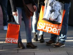 File photo dated 26/12/2017 of shoppers carrying purchases from Superdry. Fashion retailer Superdry has warned there are doubts over its ability to continue as a going concern after further lockdown measures battered its revenues (Steven Paston/PA)
