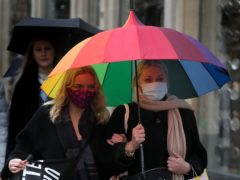 The scientists used a web-based survey to gather data on face-covering habits from more than 300,000 people (Andrew Milligan/PA)