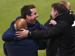 Chorley boss Jamie Vermiglio, centre, celebrates victory at Peterborough in the second round (Joe Giddens/PA)